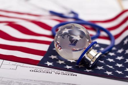 Stethoscope and globe on a USA flag Stok Fotoğraf