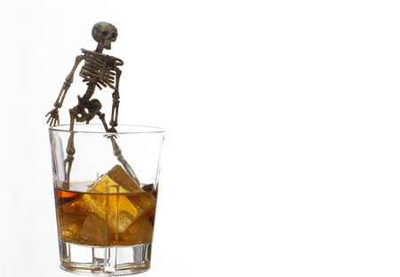 Skeleton with a Whisky. Alcoholism problem Stock Photo - 11492536
