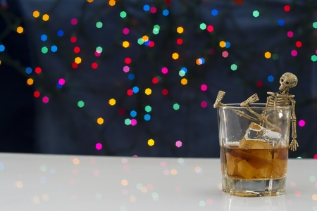 Skeleton with a Whisky. Alcoholism problem Stock Photo - 11492909