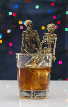 Skeleton with a Whisky. Alcoholism problem Stock Photo - 11492676