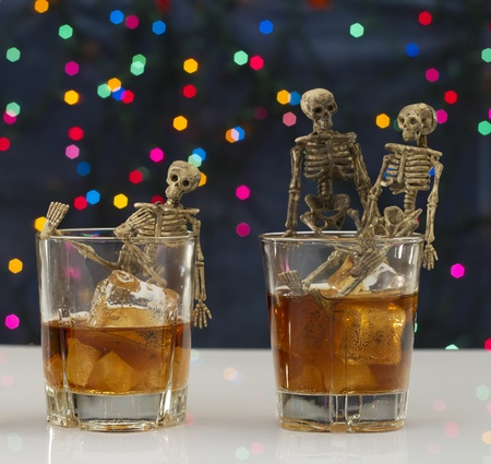 Skeleton with a Whisky. Alcoholism problem Stock Photo - 11492847