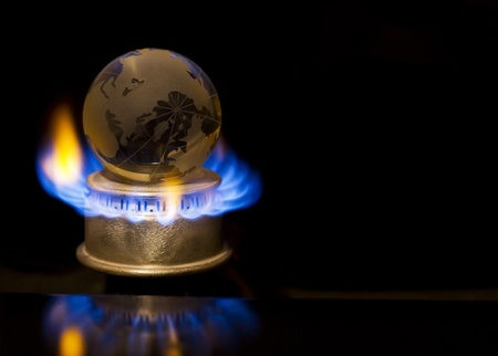 Gas flame with earth Stock Photo - 11492598
