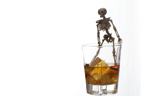 Skeleton with a Whisky. Alcoholism problem Stock Photo - 11492544