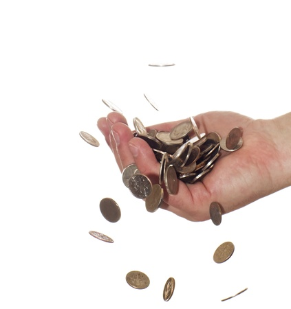 pennies: Coins falling into  hand Stock Photo