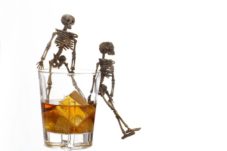 Skeleton with a Whisky. Alcoholism problem Stock Photo - 11492556