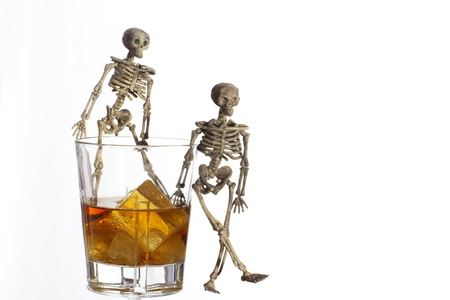 Skeleton with a Whisky. Alcoholism problem Stock Photo - 11492595