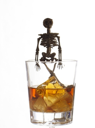 Skeleton with a Whisky. Alcoholism problem Stock Photo - 11492516