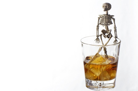 Skeleton with a Whisky. Alcoholism problem Stock Photo - 11490202