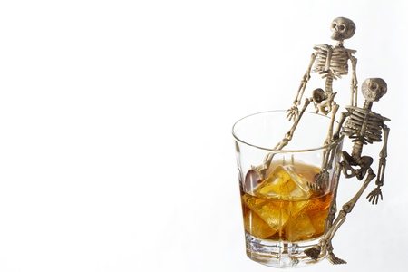 Skeleton with a Whisky. Alcoholism problem Stock Photo - 11490200