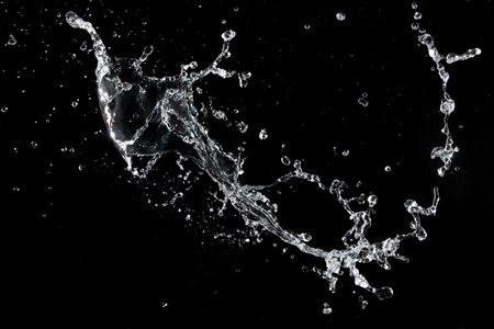 flowing water: Water splash. Isolated on black background