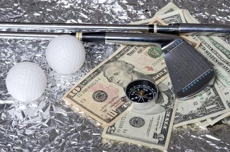 Golf club with  ball on creative metallic background  photo