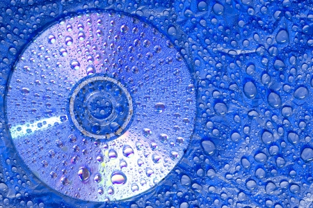 material: Water droplets on black plastic material with CD disk