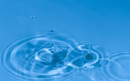 Falling drops of water. Splashing blue water  Stock Photo