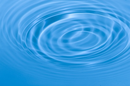 Falling drops of water. Splashing blue water