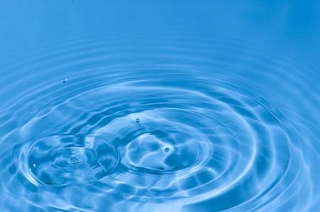 Falling drops of water. Splashing blue water Stock Photo - 12111754