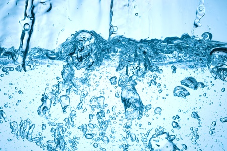Background with blue water. Creative splashing