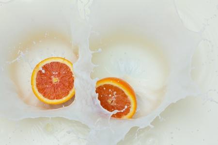 Orange and splashing milk