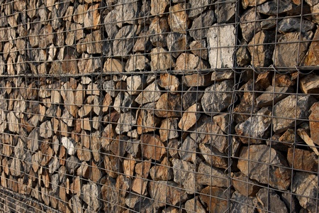 Narural stones in retain gabion wall photo