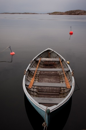 Boat on the serene water Stock Photo - 12508815