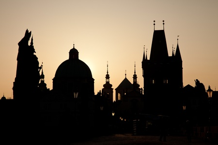 Sunrice skyline of towers from Charles bridge photo