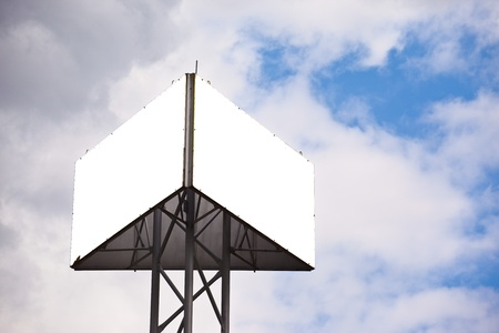 Blank sides of a triangular billboard on  blue sky with clouds photo