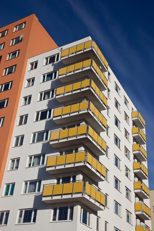 Residential building with yellow balconies