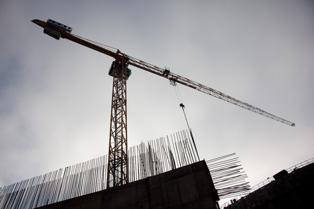 Construction crane with concrete bars Stock Photo