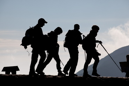 Group of young people trekking in the mountains photo