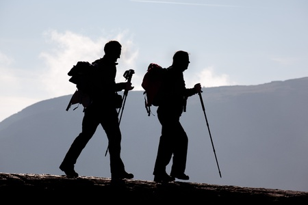 Pair on hike, walking with poles