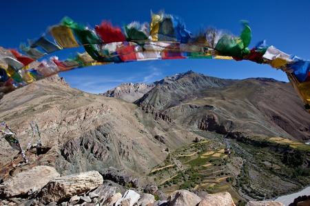 himalaya: Budhist prayer flag at the mountain saddle Stock Photo