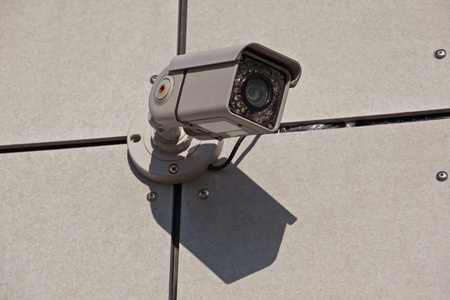 Security camera with infrared light at the building wall photo