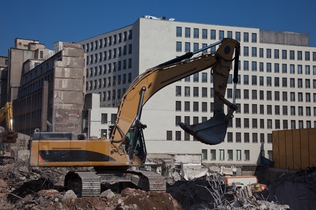 dismantling: Excavator on construction building site