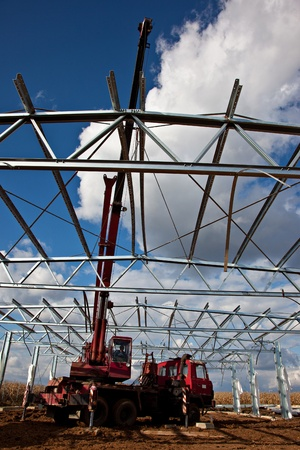 erecting: Crane assembly of steel roof truss Editorial