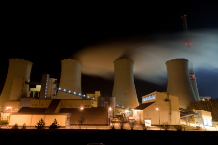 Power plan at the night with cooling towers Editorial