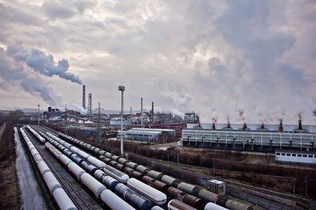 Tanks on train foreground and refinery complex Stock Photo - 13512853