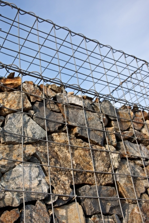Gabion wall made of natural stones photo