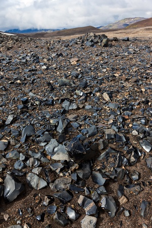 amorphous: Outcrop of obsidian  layer in volcanic rocks
