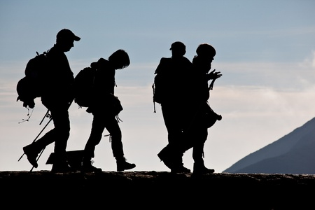 backpackers: Silhouette of hihing group in mountains