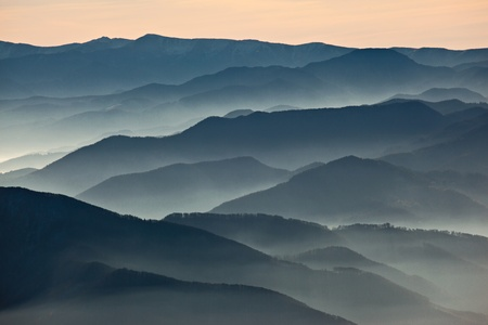 Hazy mountains ranges at dusk photo
