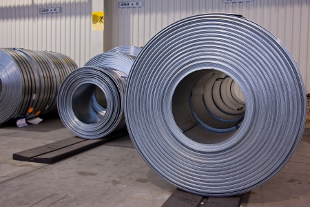 stainless: Coils of stell stripes in store Stock Photo
