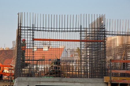 Worker prepearing concrete steel reinforcement photo