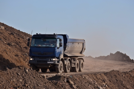 flatbed truck: Blue truck in rought terrain Stock Photo
