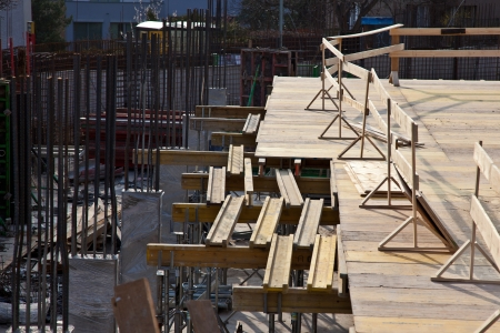 erecting: Building wood form work for concreting another floor Stock Photo