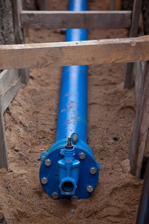 Blue water pipeline at the excavation photo
