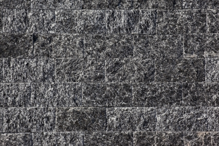 Wall of stone brick made of diorite Stock Photo