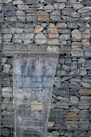 gabion: Clear water spring in gabion wall