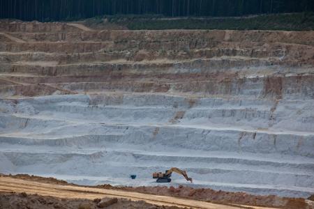 Excavator mining layer of glass sand photo