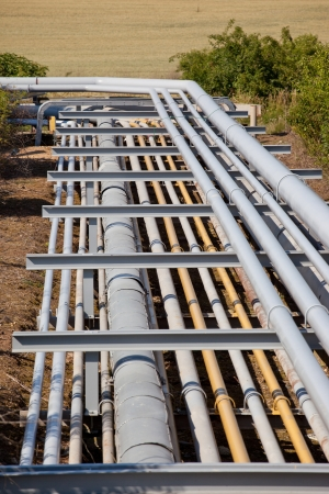 jack pump: Large pipeline construction inside oil refinery Stock Photo