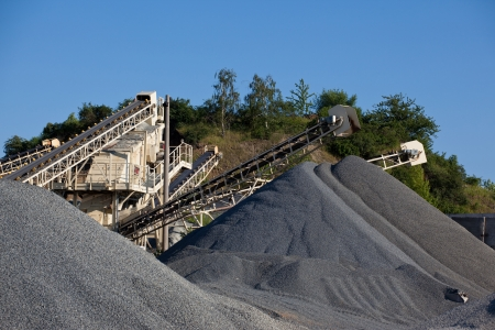 Conveyor belts with piles of gravel photo
