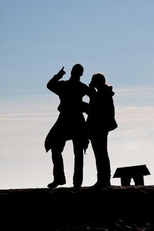 Silhouette of talking couple photo